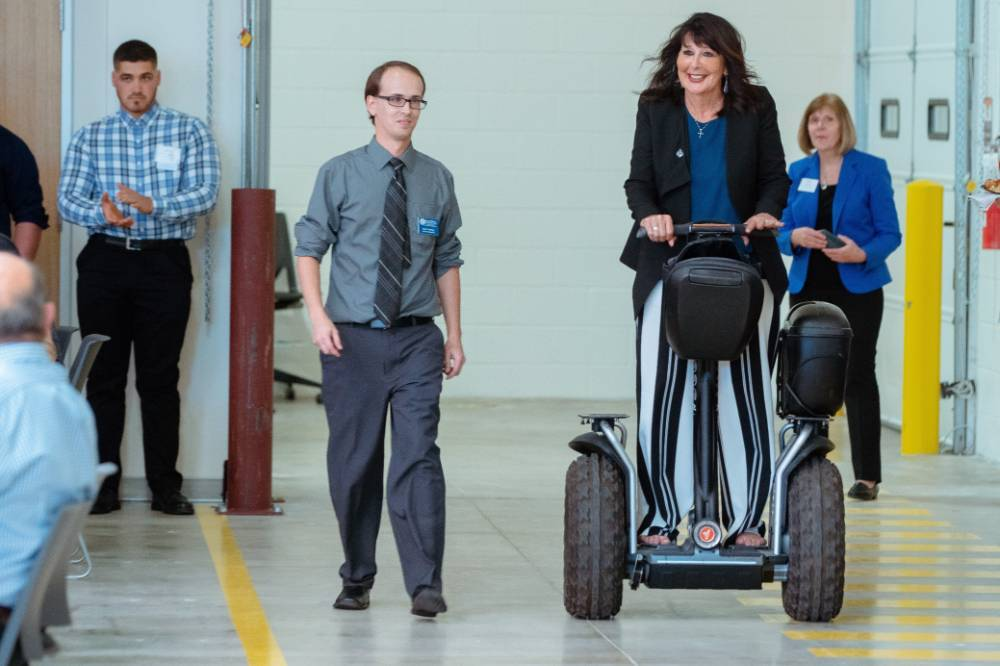 President Philomena V. Mantella riding on a segway.